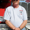 Clarence Maly pauses next to the newest Waukomis Fire Rescue truck Tuesday, June 18, 2013. (Staff Photo by BONNIE VCULEK)