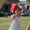 Kyra Whaley, 5, tosses a bean bag during GreEnid at Enid Farmers Market Saturday, June 22, 2013. (Staff Photo by BONNIE VCULEK)