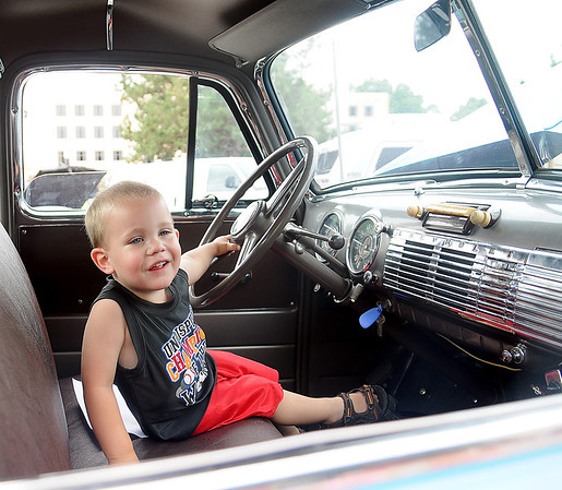 Ethan Pitts sits behind the wheel of his mother's 1953 Chevrolet Pickup during the Van Buren Cruisin Car Show in downtown Enid Saturday, June 15, 2013. Jennifer and Josh Pitts have cared for the vehicle since her grandfather restored the truck for her. (Staff Photo by BONNIE VCULEK)