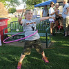 Zoe Walker hula hoops and twirls for Relay for Life donations Friday, June 7, 2013. Walker's brother  J.T. Beall, who graduated from Chisholm High School in May, was diagnosed with a brain tumor last December. (Staff Photo by BONNIE VCULEK)