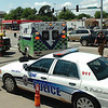 An ambulance moves through the congested intersection of Garriott and Van Buren Wednesday as it takes the victim of a vehicle vs pedestrian accident to hospital. (Staff Photo by BILLY HEFTON)
