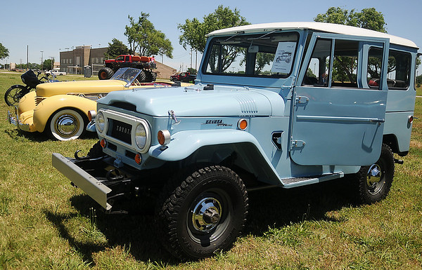 Over the last three years, Fred Blaser has restored his 1969 Toyota FJ-40 Land Cruiser to original condition. The 155-horse power vehicle was one of the entries in  the Cimarron Chapter of the Boy Scouts of America Car Show at the Garfield County Fair Grounds Saturday, June 1, 2013. (Staff Photo by BONNIE VCULEK)