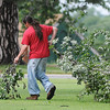 A maintenance worker at Northern Oklahoma College-Enid clears fallen tree limbs from the campus after a severe thunderstorm moved across Garfield County early Wednesday, June 5, 2013. (Staff Photo by BONNIE VCULEK)