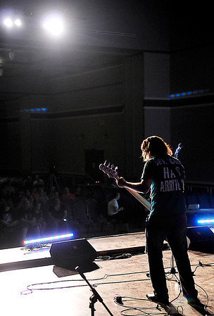 Zach Close, bassist for the band Downside, performs during the Club MOE Tornado Relief concert Sunday at Convention Hall. (Staff Photo by BILLY HEFTON)
