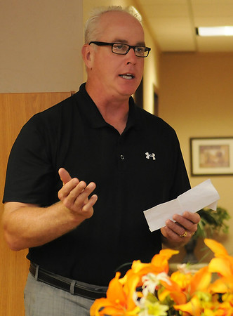 Hank Ross, owner of Ross Home Health, addresses his employees during their 10th anniversary party at 427 E. Cherokee Wednesday, June 26, 2013. (Staff Photo by BONNIE VCULEK)