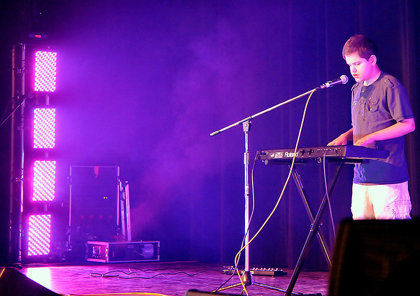 Cobe performs during the Club MOE Tornado Relief concert Sunday at Convention Hall. (Staff Photo by BILLY HEFTON)