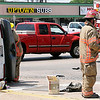 An Enid firefighter visits with a crash victim at the intersection of Owen K. Garriott and Johnson Friday, June 21, 2013. Enid Fire Department, Enid Police Department and Life EMS responded to the scene. (Staff Photo by BONNIE VCULEK)
