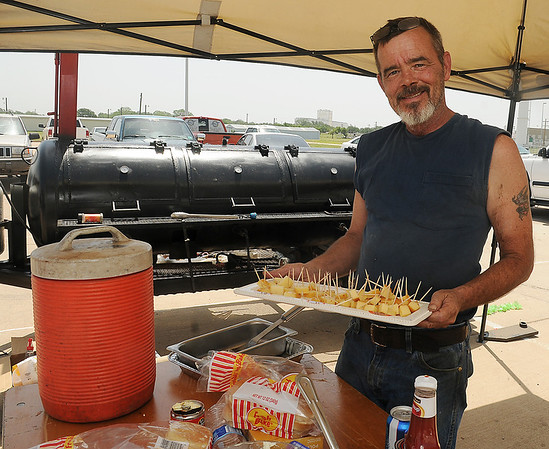 Mark Hickman, from Albion, Neb., smoked several types of cheese during the Make-A-Burger fundraiser for Make-A-Wish Foundation Saturday, June 22, 2013. (Staff Photo by BONNIE VCULEK)