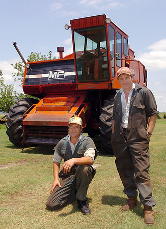 Steven and Kevin Clarke in front of a 1971 Massey Ferguson Model 760 combine that have working to restore since mid-May. The Massey Ferguson combine was the first of 10 such combines manufactured in 1971. (Staff Photo by BILLY HEFTON)