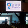 A guest's silhouette appears near two of the Enid Event Center hospitality suites as he photographs the arena below him during the grand opening of the facility in downtown Enid Wednesday, June 12, 2013. (Staff Photo by BONNIE VCULEK)