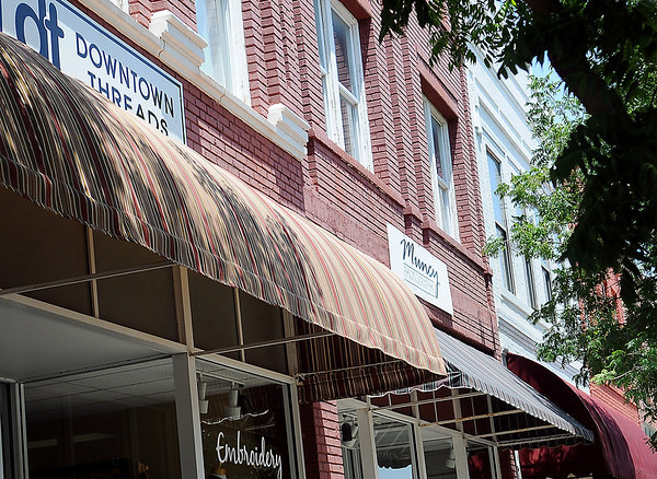 A new awning cover over the entrance to Downtown Threads is the latest awning cover made by Marilyn Hawkins, from Derrick Canvas Shop at 1006 Kline. (Staff Photo by BONNIE VCULEK)