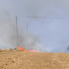 Brush units from the  Breckenridge and Enid Fire Departments team up while fighting a wheat field fire along Wheat Capital Rd. and between 72nd and 90th streets Monday. (Staff Photo by BILLY HEFTON)