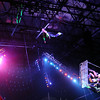 An extreme swing world class performer sails toward a hoop high above the Enid Event Center floor during Cirque Musica Thursday, June 27, 2013. (Staff Photo by BONNIE VCULEK)