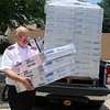 """Capt. Ernie Hull carries Lasko 20"""" box fans into the Salvation Army Thursday, June 20, 2013. Sixty fans were donated and delivered to the local charity by O.G.&E. corporate representative, Troy Crowley. (Staff Photo by BONNIE VCULEK)"""