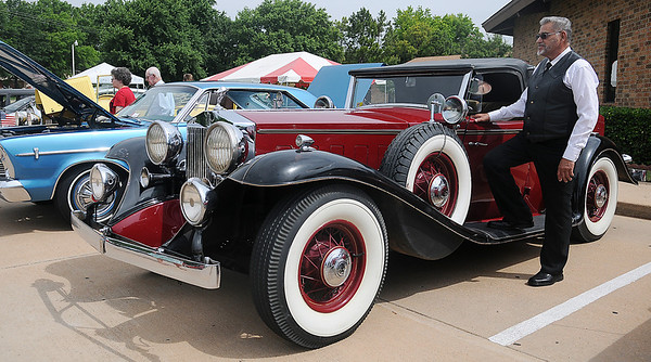 Charlie Todd pauses near his restored 1932 Rolls Royce during the 9th annual Dad Fest at Enid First Assembly of God Sunday, June 16, 2013. (Staff Photo by BONNIE VCULEK)