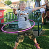 Zoe Walker hula hoops and twirls a baton at the same time as she entertains the crowd at the Camo Crew booth for donations during Relay for Life Friday, June 7, 2013. (Staff Photo by BONNIE VCULEK)