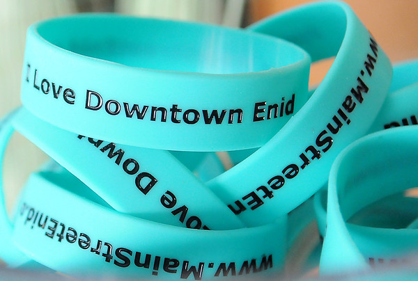 I Love Downtown Enid bracelets appear inside the Main Street Enid office at the CDSA Community Solutions Non-profit Center Thursday, June 6, 2013. Main Street Enid is just one of the 501-C3 businesses that have moved into the Non-profit Center since it opened one year ago. (Staff Photo by BONNIE VCULEK)