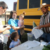 "A family purchases fresh kale from the Rowdy Stickhorse ""Traveling Desperado"" Market Bus during Enid Farmers Market Saturday, June 1, 2013. (Staff Photo by BONNIE VCULEK)"