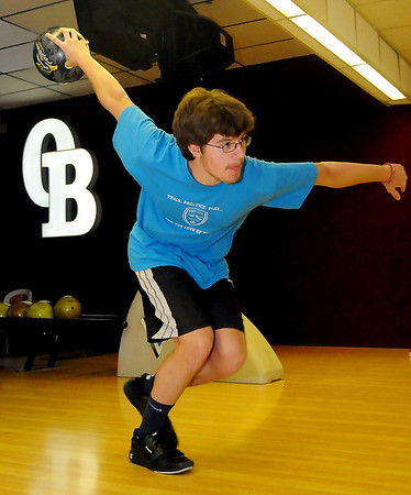 Kelsy Peck bowls a frame during youth scholarship bowling at Oakwood Bowl Tuesday, June 11, 2013. Peck, a 16-year-old junior at Enid High School, averages 171. His high game score has been a 234, with a series high of 609. Youth who participate in the scholarship program range in age from 5-18 and as they bowl, they earn money toward college or trade school expenses. (Staff Photo by BONNIE VCULEK)