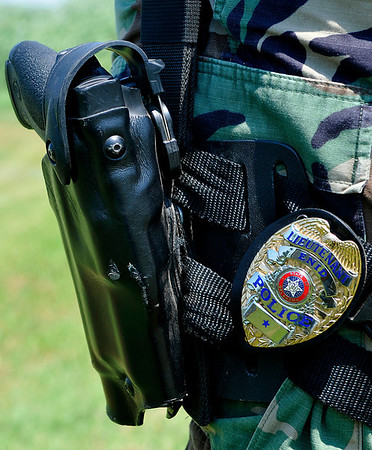 Side arm of Lt. Warren Wilson, of the Enid Police Department, who has had an article published in Police Marksman magazine about pros and cons of pistol-mounted lights. (Staff Photo by BILLY HEFTON)