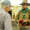 Cody Joliff (right) holds a tin canteen as he visits with James Shey, from Ringwood, during the Cherokee Strip Regional Heritage Center's Living History day Saturday, June 8, 2013. (Staff Photo by BONNIE VCULEK)