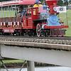 The Kiwanis's Meadowlake Flyer crosses a trellus bridge at Meadowlake Park Saturday, June 8, 2013. (Staff Photo by BONNIE VCULEK)