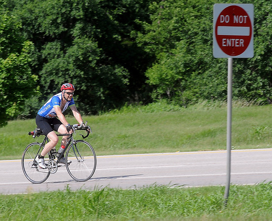 A cyclist travels north on U.S. 81 as he trains for a race Friday, June 21, 2013. (Staff Photo by BONNIE VCULEK)