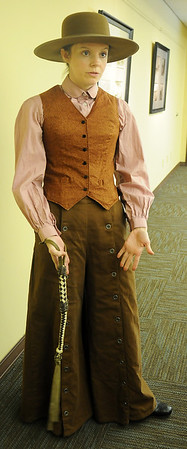 Sarah Owens dons clothing that would have been worn by a lady homesteader during the Cherokee Strip Regional Heritage Center Living History Day Saturday, June 8, 2013. (Staff Photo by BONNIE VCULEK)