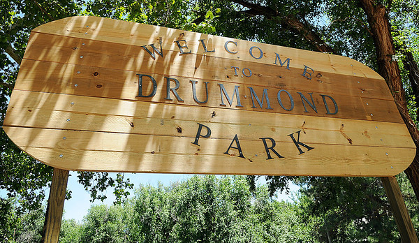 A new sign welcomes the Drummond community and guests to the city's park. Dillon Throckmorton designed and built the sign and flower gardens at the entrance to the park for his Eagle Scout project. (Staff Photo by BONNIE VCULEK)