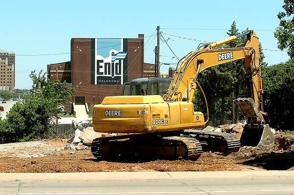 A tract hoe sits at the intersection of Independence and Garriott after demolishing the building on the lot. (Staff Photo by BILLY HEFTON)