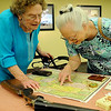 Barbara Argo, from the state of Washington, and Carolyn Morris, from Enid, examine an 1889 map of Oklahoma during the Cherokee Strip Regional Heritage Center Living History Day Saturday, June 8, 2013. (Staff Photo by BONNIE VCULEK)