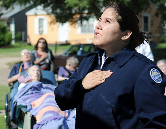 Enid High School ROTC Cadet Major Laisa Pack glances upward as she says the Pledge of Allegiance during a special American flag ceremony at The Living Center, 1409 N. 17th, Sunday, June 30, 2013. (Staff Photo by BONNIE VCULEK)
