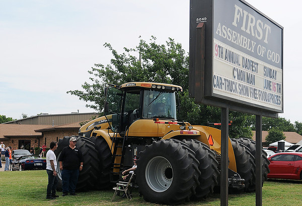 An Agco Challenger MT975C draws attention during the 9th annual Dad Fest at the Enid First Assembly of God Sunday, June 16, 2013. The enormous implement stands 14 feet tall, weighs 60,000 lbs. and costs $360,000. (Staff Photo by BONNIE VCULEK)
