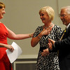 Sharon Trojan (center) receives congratulations from Andi Holland (left) and George Pankonin (right) as she is honored as the Greater Enid Chamber of Commerce Volunteer of the Year during the annual meeting and banquet at the Enid Convention Hall Thursday, June 20, 2013. (Staff Photo by BONNIE VCULEK)