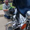 Tracy Roberts dusts his Harley-Davidson touring bike during the 9th annual Enid First Assembly of God Dad Fest Sunday, June 16, 2013. (Staff Photo by BONNIE VCULEK)