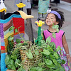 Emily Fields peers toward crochet flowers during the Yarnover Enid Knit or Crochet in Public Week Kick-Off in the mid-block walkway on W. Randolph Friday, June 7, 2013. (Staff Photo by BONNIE VCULEK)