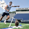 Former Enid Plainsmen place kicker, J.P. Maciel, practices field goals at D. Bruce Selby Stadium Tuesday. (Staff Photo by BILLY HEFTON)