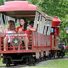 Two young ladies admire the beauty at Meadowlake Park as they ride on the Meadowlake Flyer caboose Saturday, June 8, 2013. (Staff Photo by BONNIE VCULEK)