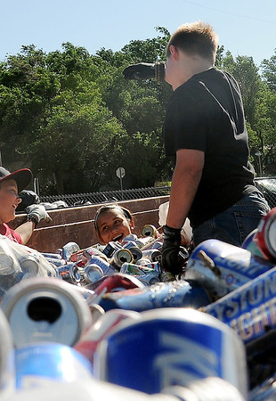 Wildhorse Gang members, from Kremlin, fill Southside Recycling trailers with aluminum cans during their 16th annual event can round-up Tuesday, June 11, 2013. (Staff Photo by BONNIE VCULEK)