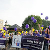 Cancer survivors and their caregivers release their balloons as the survivors' victory lap begins during Relay for Life in downtown Enid Friday, June 7, 2013. (Staff Photo by BONNIE VCULEK)