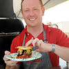 Michael Flach, from PaPa Murphy's, with his winning gourmet burger entry. (Staff Photo by BONNIE VCULEK)
