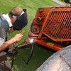 Steven Clarke does some welding on a 1971 Massey Ferguson Model 760 combine that he and his brother, Kevin, have working to restore since mid-May. The Massey Ferguson combine was the first of 10 such combines manufactured in 1971. (Staff Photo by BILLY HEFTON)