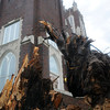 A fallen American Elm tree truck frames the front entrance to the First Presbyterian Church after a gust front moved through Enid early Wednesday, June 5, 2013. City of Enid crews blocked the 500 block of West Maines as they removed the debris from the street. (Staff Photo by BONNIE VCULEK)
