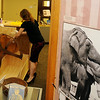 """David Kennedy and Sarah Owens unpack an elephant head dress as they prepare the temporary exhibit  """"Behind the Scenes of the Circus Big Top 1890-1965"""" at the Cherokee Strip Regional Heritage Center Wednesday, June 12, 2013. (Staff Photo by BONNIE VCULEK)"""