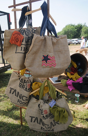La Belle Bella, handmade upcycled burlap couture bags created by Danell Harrison, were made with coffee bean bags. Harrison has a booth at Enid Farmers Market each week. (Staff Photo by BONNIE VCULEK)