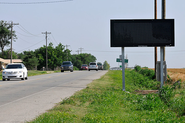 Traffic flows pass one of two electronic message signs that have been installed, one on Cleveland and the other on Southgate near the entrances to Vance Air Force Base. The signs will be operated by 71st Security Forces Squadron and will display updates on gate closures and other traffic-related announcements. (Staff Photo by BILLY HEFTON)