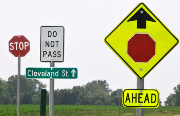 Warning signs on the Enid Trail system. (Staff Photo by BILLY HEFTON)