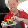 Michael Flach assembles a PaPa's Favorite Pizza Burger during Make-A-Burger for Make-A-Wish at the Chisholm Trail Expo Center. More than $10,000 was raised during the event. Cummins Construction PaPa Murphy's unique burger was the judges' favorite. (Staff Photo by BONNIE VCULEK)