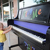 Little Levi Ford tickles the keys of an upright piano during First Friday activites in downtown Enid June 7, 2013. (Staff Photo by BONNE VCULEK)