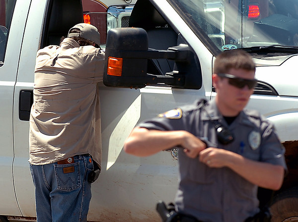 The distraught driver of a pickup involved in a vehicle vs pedestrian accident at intersection of Garriott and Van Buren Wednesday lays his head on the window after talking to police. (Staff Photo by BILLY HEFTON)